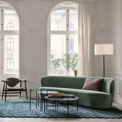 GUBI Gravity Floor Lamp by Space Copenhagen in living room with Stay Sofa TS Tables and Masculo Lounge Chair