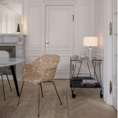 GUBI Gravity Table Lamp by Space Copenhagen in room with Mategot Trolley and Bat Dining Chair