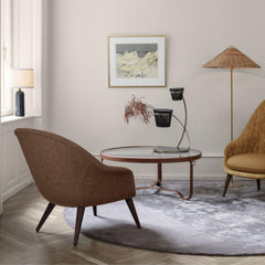 GUBI Gravity Table Lamp by Space Copenhagen in room with Paavo Tynell Floor Lamp, Adnet Coffee Table, and Bat Lounge Chairs