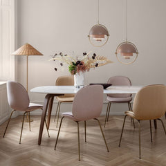 GUBI Paavo Tynell Floor Lamp in dining room with Beetle Chairs and Multilite Pendants