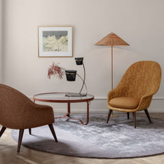 Gubi 9602 Floor Lamp with Wicker Willow Shade in room with Bat Lounge Chairs and Adnet Coffee Table