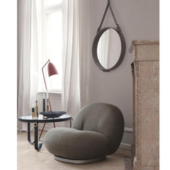 GUBI Pacha Lounge Chair by Pierre Paulin in room with Adnet Mirror and Grasshopper Lamp