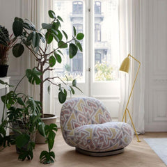 GUBI Pacha Lounge Chair by Pierre Paulin in room with yellow Greta Grossman Grasshopper Lamp