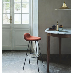 Gubi Semi Pendant in Brass in room with marble table and 3D Stool by Komplot Design