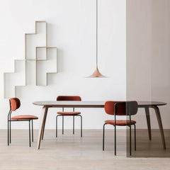 GUBI Coco Dining Chairs in room with Semi Pendant Light