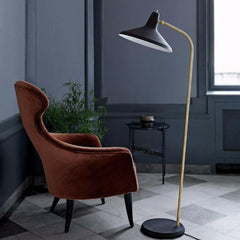 GUBI TS Side Table all black by Gam Fratesi in room with Eva Lounge Chair and G10 Floor Lamp