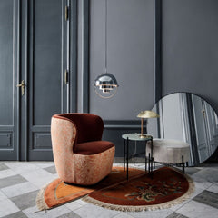 GUBI Wall Mirror Black Brass in room with Mulitlite Pendant and Stay Chair