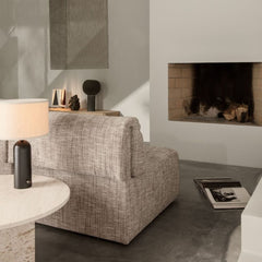 GUBI Wonder Sofa by Space Copenhagen in room with fireplace