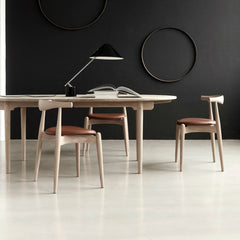 Hans Wegner CH20 Elbow Chairs in Room Carl Hansen & Son Palette & Parlor
