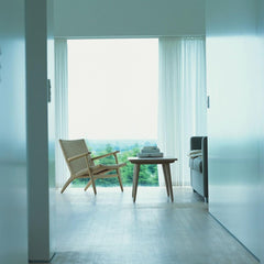 Wegner CH25 Lounge Chair in Oak White Oil in room with CH008