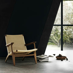 Hans Wegner CH25 Longe Chair Smoked Oak with Natural Paper Cord In Room Carl Hansen & Son