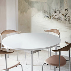 Hans Wegner CH388 Dining Table White with CH88 Chairs in Room with Mural Carl Hansen & Son