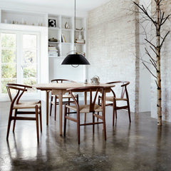 Walnut Wegner Wishbone Chairs in Dining Room with Louis Poulsen Light