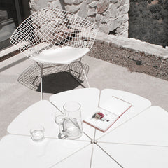Harry Bertoia Diamond Chair with White Cushion Outdoors with Petal Table Knoll
