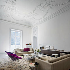Bertoia Diamond Chairs in Chrome with Purple Covers in Room in Europe Knoll