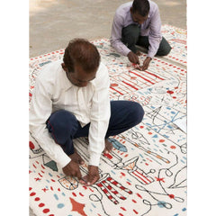 Nani Marquina Hayon x Nani Rug being made by two craftsmen