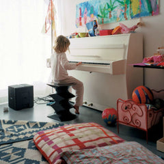 Herzog and de Meuron Hocker Stool Espresso in room with little girl playing piano Vitra