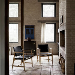 Borge Mogensen Huntsman Chairs black leather by fireplace Carl Hansen & Son