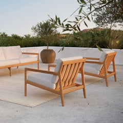 Jack Teak Outdoor Lounge Chairs and Sofa with Off-White Cushions and Sand Nomad Kilim Rug by Ethnicraft