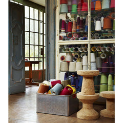 Jasper Morrison Cork Stools in Room with Colorful Spools of Yarn