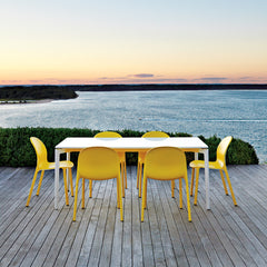 Jonathan Olivares Yellow Outdoor Chairs at Sunset