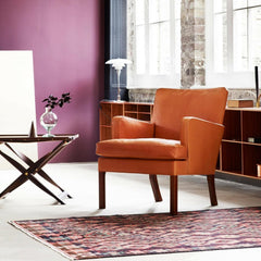 Kaare Klint Easy Chair in Room with Propeller Stool