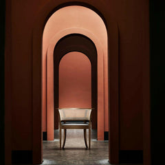 Faaborg Chair in Walnut by Kaare Klint for Carl Hansen and Son in Hallway with Arches
