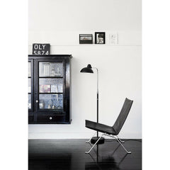 Kaiser Idell Luxus Floor Lamp Black in room with Poul Kjaerholm Chair