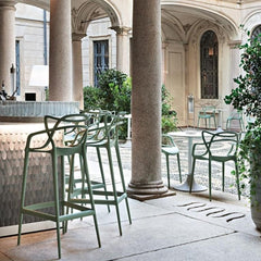 Kartell Masters Stools and Chairs in outdoor bar in Italy