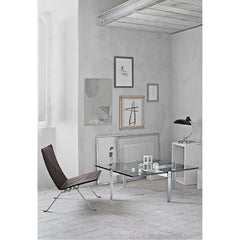 Kaiser Idell Luxus Table Lamp Gloss Black in room with Poul Kjaerholm Collection