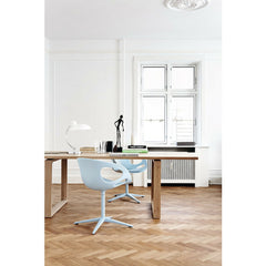 Kaiser Idell Luxus Table Lamp Gloss White in room with light blue Rin Chairs