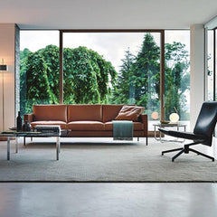 Knoll Armless Low Back Pilot Lounge Chair in room with Barcelona Table