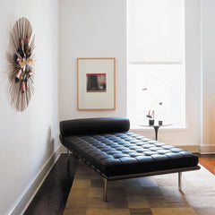 Knoll Barcelona Couch Black Leather in room with Saarinen side table
