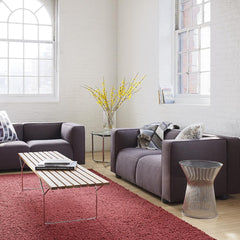 Knoll Bertoia Bench in room with Barber Osgerby Sofas and Platner Side Table