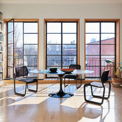 Knoll Newson Aluminum Chairs in room with Saarinen Dining Table