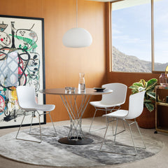 Knoll Noguchi Cyclone Table in room with Bertoia Molded Shell Chairs