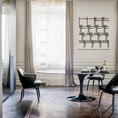 Knoll Saarinen Oval Dining Table Black Polished Nero Marquina Marble in room with Saarinen Executive Dining Chairs