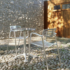 Knoll Pensi Cafe Table on Stone Patio with Toledo Chairs