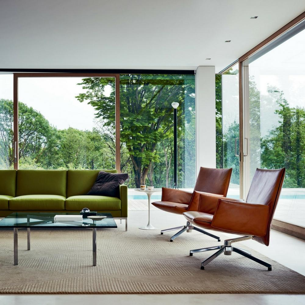 Knoll Pilot Swivel Chairs By Barber Osgerby In Room With Barcelona Table  And Dark Green Sofa