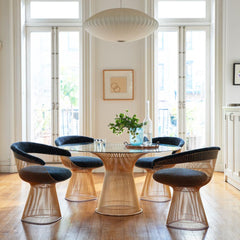 Knoll Platner Dining Table Gold in room with Platner Armchairs