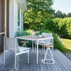 Richard Schultz Dining Chairs and Dining Table Outdoors with Barber Osgerby Piton Stools