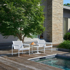 Knoll Richard Schultz Lounge Chairs by pool with Petal Table and Saarinen Outdoor Side Table
