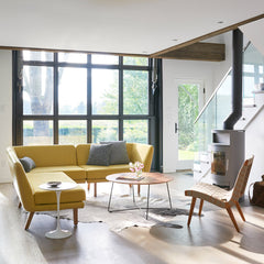 Knoll Risom Lounge Chair in living room with Unscripted Sofa and Saarinen Side Table