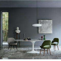Knoll Marble Saarinen Oval Dining Table in room with Green Velvet Saarinen Executive Chairs