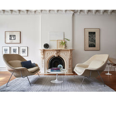 Knoll Saarinen Womb Settees in Room with Tulip Side Table