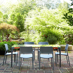 Knoll Spark Dining Chairs outdoors with Stromborg Table