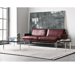 Piero Lissoni Two Seat Sofa Burgandy Leather in Room with Poul Kjaerholm Table and Stool
