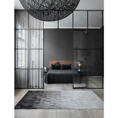 Linie Design Fade Grey Cowhide Rug in Bedroom