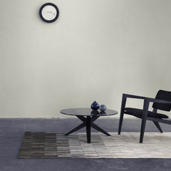 Linie Design Fade Grey Cowhide Rug in Room with Table and Chair