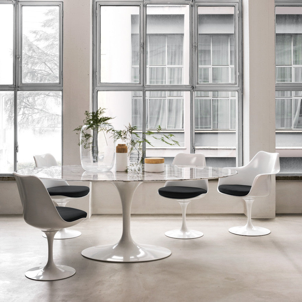 White Saarinen Tulip Chairs With Black Cushions Around Oval Marble Saarinen  Table Knoll